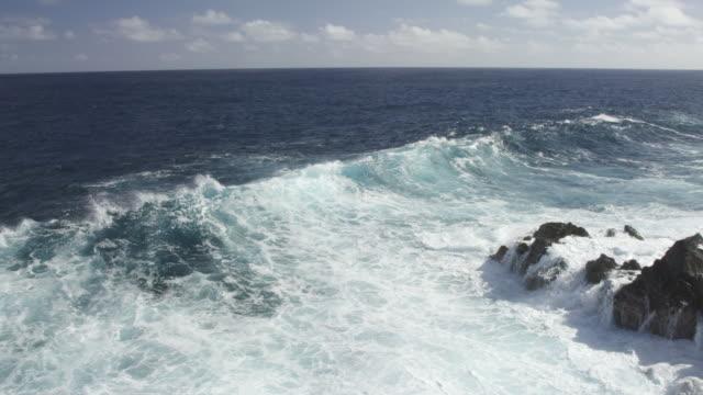 ms pan slo mo shot of waves crashing into rocks with big splash / waipio, hawaii, united states - boulder stock videos & royalty-free footage