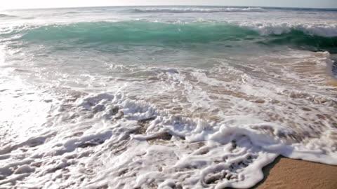 cu shot of waves crushing to sandy beach / polihe beach, kauai hawaii, united states - kauai stock videos & royalty-free footage