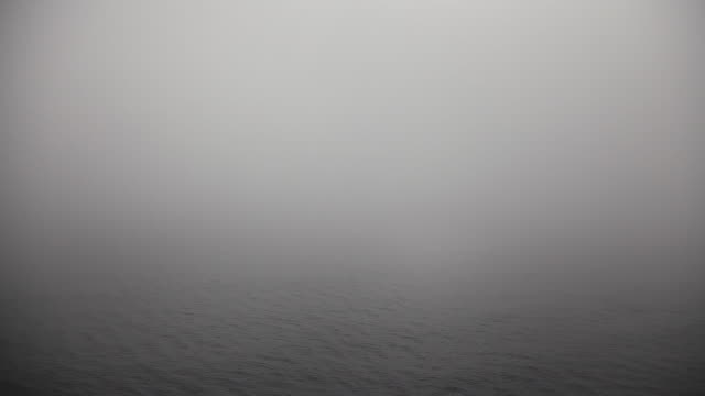 ms shot of waves in sea under thick layer of fog - boat point of view stock videos & royalty-free footage