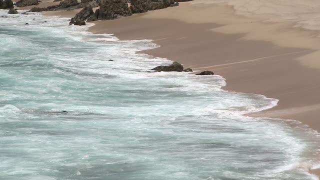 MS Shot of Waves lapping at small beach next to Medano beach / Cabo San Lucas, Baja California Sur, Mexico