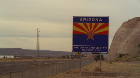 ms shot of welcome to arizona sign board next to rural highway - welcome sign stock videos & royalty-free footage