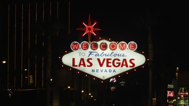 MS Shot of welcome to fabulous Las Vegas sign at night / Las Vegas, Nevada, United States