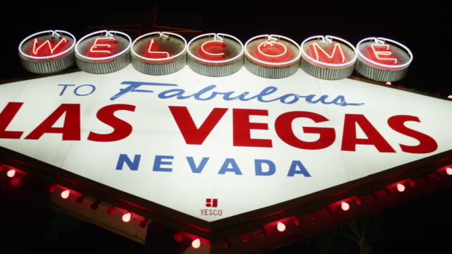 CU PAN Shot of welcome to fabulous Las Vegas sign at night / Las Vegas, Nevada, United States