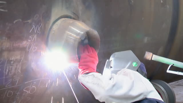 cu shot of welder working on pressure vessel / johannesburg, gauteng, south africa - ハウテング州点の映像素材/bロール