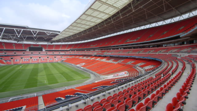 WS PAN Shot of Wembley stadium interior from mid tier seating / London, London, United Kingdom