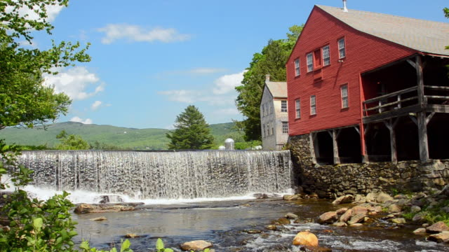 MS PAN Shot of Weston Vermont river old mill and barn by water / Weston, Vermont, United States