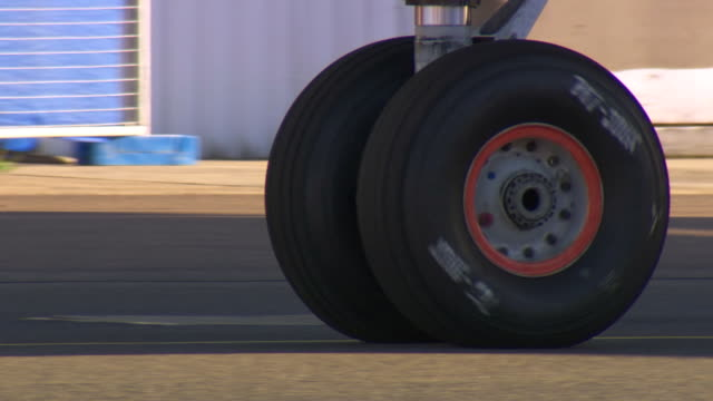 cu ts shot of wheels of plane / mascot, new south wales, australia - wheel stock videos & royalty-free footage