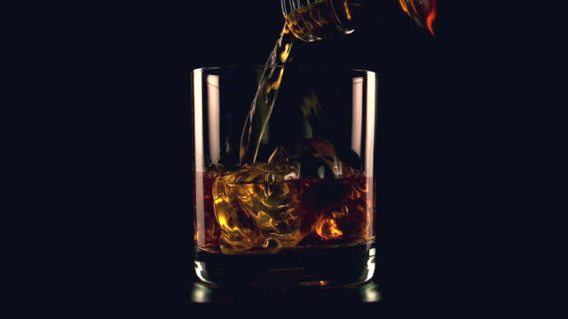 cu shot of whiskey pouring in glass / spain - alcohol drink stock videos & royalty-free footage