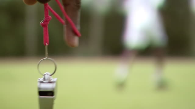 vídeos de stock e filmes b-roll de ms slo mo shot of whistle dangling from man's hand during soccer match / johannesburg, gauteng, south africa - material