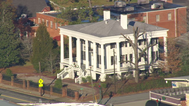 ms aerial shot of white building / georgia, united states - front stoop stock videos and b-roll footage