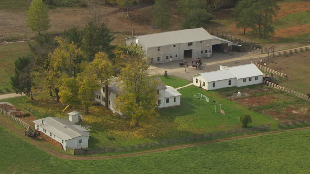 MS DS AERIAL Shot of white house and farm in rural area / Bergholz, Ohio, United States