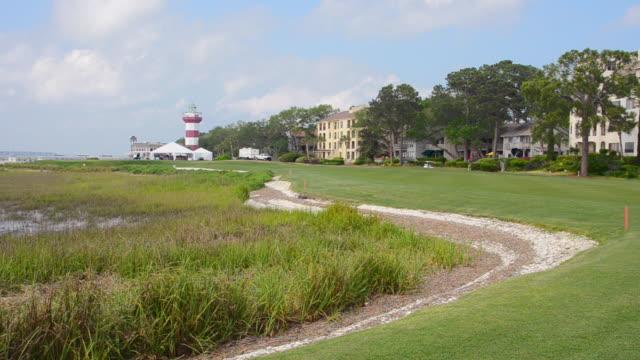 WS Shot of white light house and empty golf course / Hilton, Head South Carolina, United States