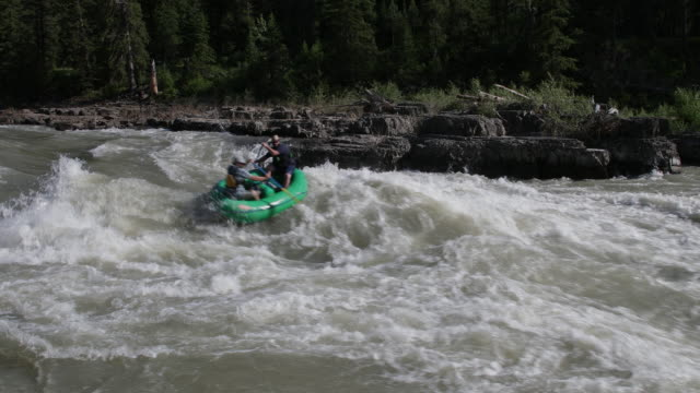 WS 4K shot of white water rafters on the Snake River