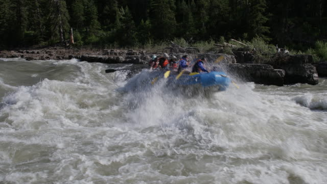 ws 4k shot of white water rafters on the snake river - inflatable raft stock videos and b-roll footage
