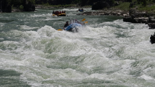 WS 4K shot of white water rafters/kayakers on the Snake River, Wyoming