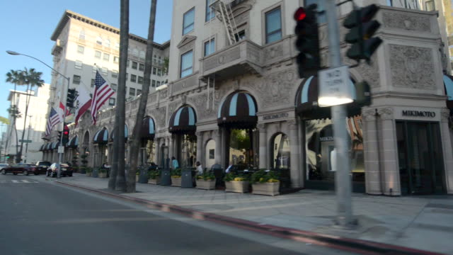ms pov shot of wilshire hotel with street / beverly hills, california, united states - beverly hills stock-videos und b-roll-filmmaterial