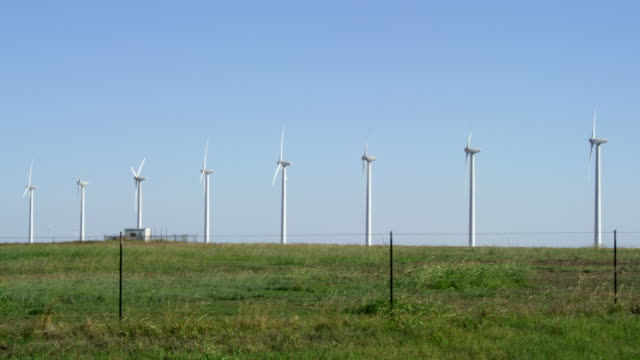 ws shot of wind turbines in field / texas, united states - medium group of objects stock videos & royalty-free footage