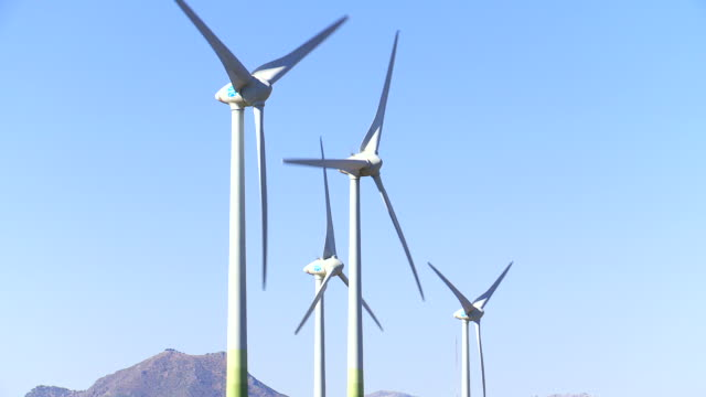 vídeos de stock e filmes b-roll de  ms shot of wind turbines / manilva, malaga - quatro objetos