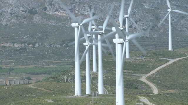 MS AERIAL Shot of wind turbines moving with breeze / Crete, Greece