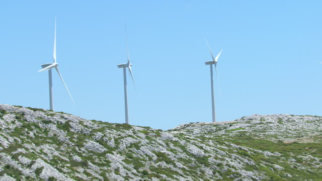 MS AERIAL TS Shot of wind turbines on top of mountain / Peloponnese, Greece
