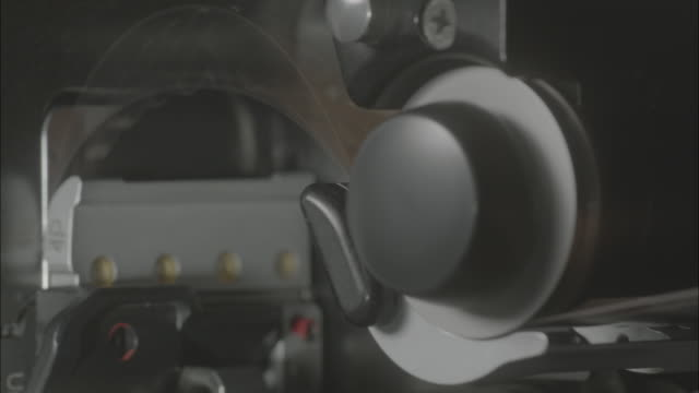 shot of winding film in camera - film stock videos & royalty-free footage