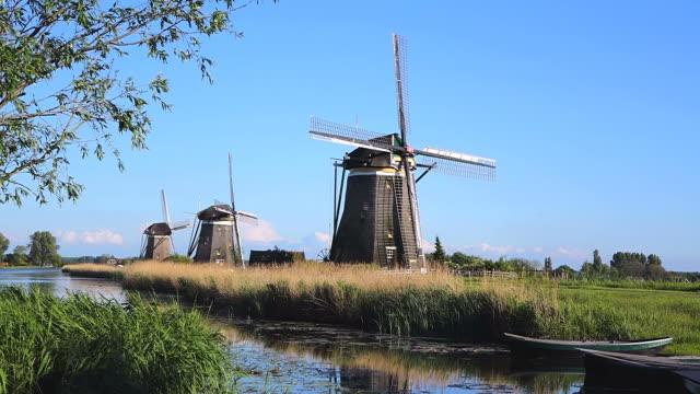 ws shot of windmills near leidschendam / south holland, netherlands - mill stock videos & royalty-free footage
