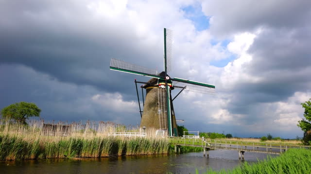 ws shot of windmills near leidschendam / south holland, netherlands - south holland stock videos and b-roll footage