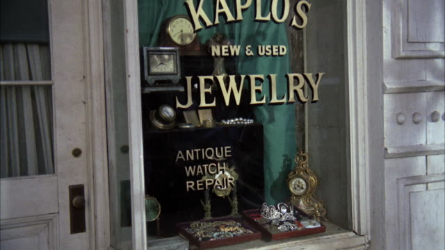 CU Shot of window of kaplos new and used jewelry store
