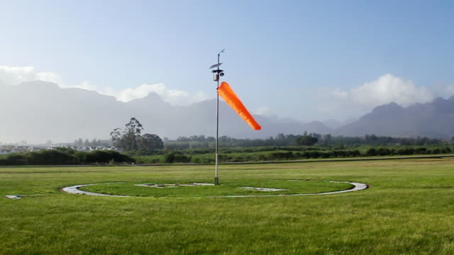 ws slow mo shot of windsock at airport / stellenbosch, western cape, south africa - stellenbosch stock videos and b-roll footage