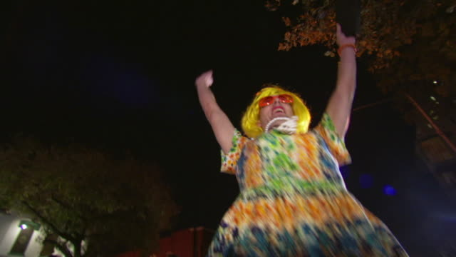 ms pov shot of winner of 2007 high heel race crosses finish line and accepts trophy / washington, dist. of columbia, united states - drag queen stock videos and b-roll footage