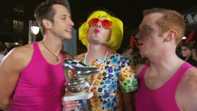 ms shot of winner of 2007 high heel race poses with trophy / washington, dist. of columbia, united states - drag queen stock videos and b-roll footage