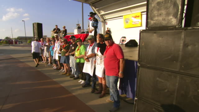 ws pov shot of winners standing in line under podium wearing medals during worlds championship chili cook off / omaha, nebraska, united states - medallist stock videos & royalty-free footage