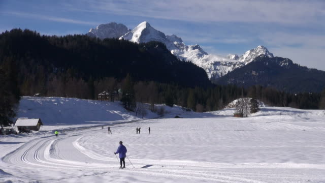 ws shot of winter sports near elm au, werdenfelser land / mittenwald, bavaria, germany - werdenfelser land stock videos and b-roll footage