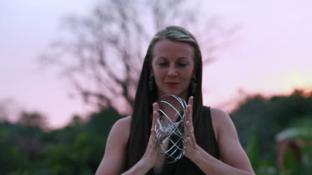 ms ts shot of woman doing tricks with steel matrix / montezuma, costa rica - magic trick stock videos & royalty-free footage