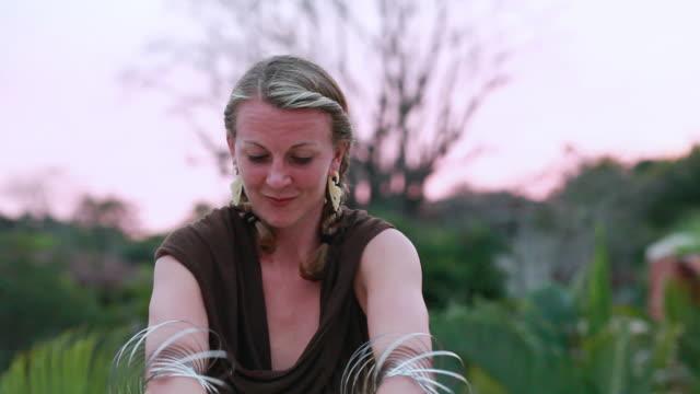 vidéos et rushes de ms ts shot of woman doing tricks with steel matrix / montezuma, costa rica - illusion