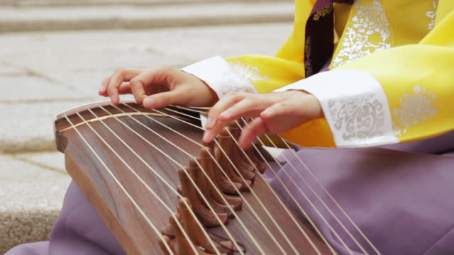 cu shot of woman hands playing gayageum ( traditional korean zir-like string instrument) / yongin, gyeonggido, south korea - string instrument stock videos & royalty-free footage