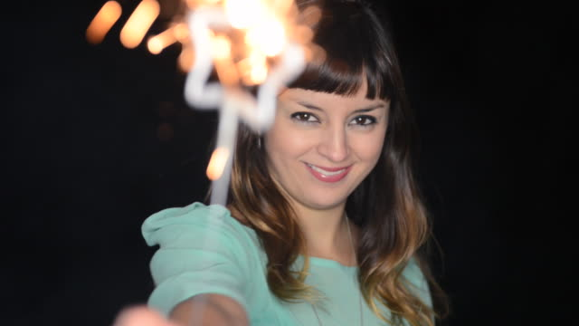 ms shot of woman holding sparkler and smiling / london, greater london, united kingdom - greater london stock videos & royalty-free footage
