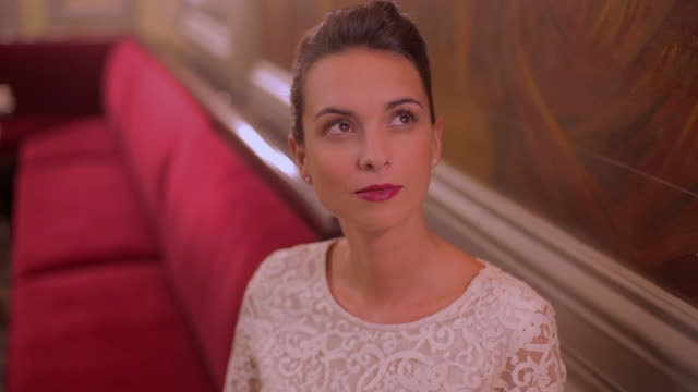 cu shot of woman in evening wear at restaurant / toulouse, haute garonne, france - evening wear stock videos & royalty-free footage
