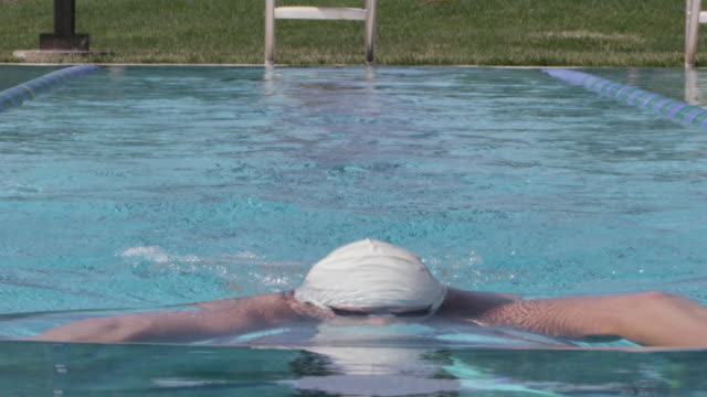cu slo mo shot of woman in swim cap swimming breast stroke / davis, california, united states  - swimming cap stock videos & royalty-free footage
