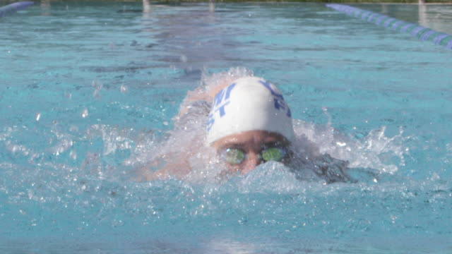 cu slo mo shot of woman in swim cap swimming butterfly stroke / davis, california, united states  - swimming cap stock videos & royalty-free footage