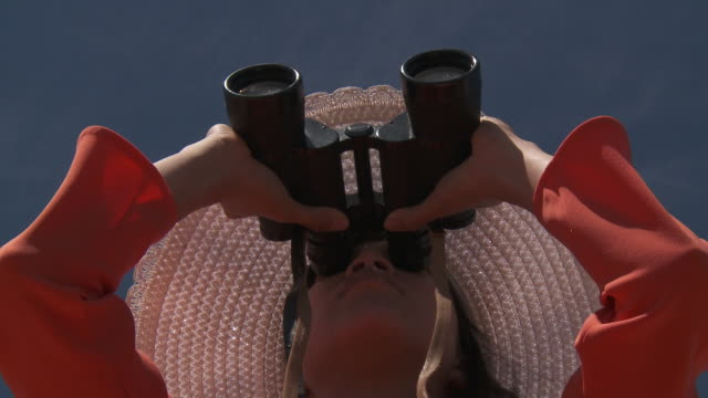 shot of woman looking with binoculars. - binoculars stock videos & royalty-free footage