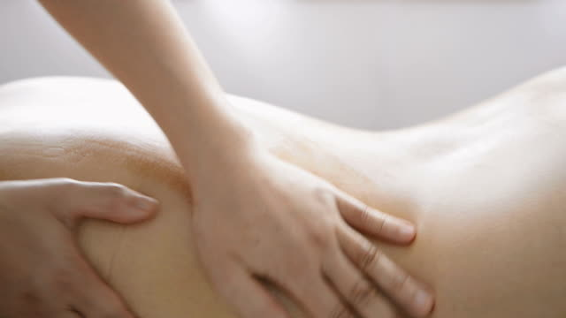CU TU Shot of woman receiving oil massage / Kyoto, Japan