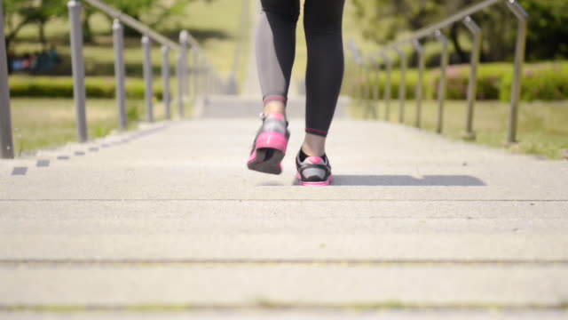 ms tu shot of woman runs down stairs / uji, kyoto, japan  - steps and staircases stock videos & royalty-free footage
