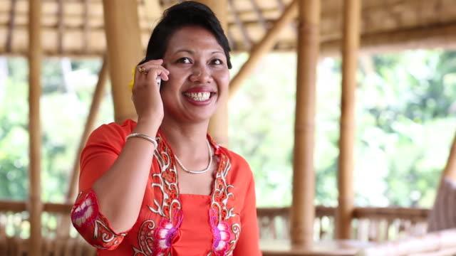 CU Shot of woman talking on her cellphone / Ubud, Bali, Indonesia