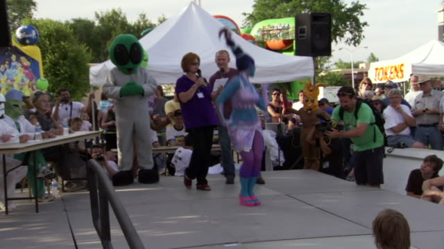 ms ts shot of woman walking and posing on stage during roswell ufo festival costume contest / roswell, new mexico, united states - roswell stock videos & royalty-free footage