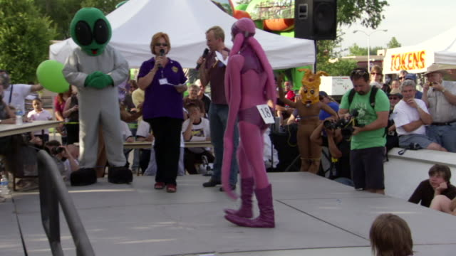 ms ts shot of woman walking and posing onstage during roswell ufo festival costume contest / roswell, new mexico, united states - roswell stock videos & royalty-free footage