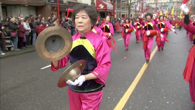MS Shot of Women playing traditional drums and cymbals AUDIO / Vancouver, British Columbia, Canada