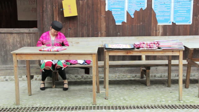 ms shot of women weaving clothes / yao village, huangluo, china - one mid adult woman only stock videos & royalty-free footage