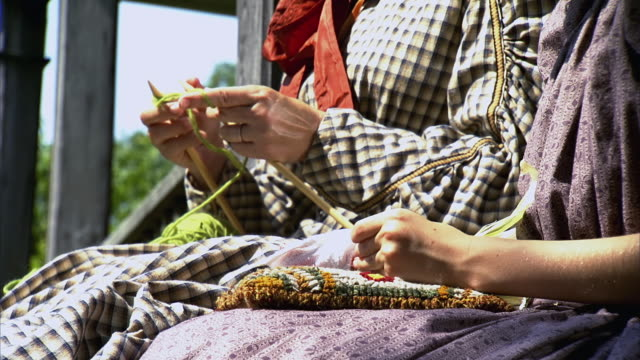 MS shot of Womens hands as they knit and embroider / Middleburg, Virginia, United States