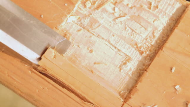 cu shot of wood chisel chiseling wood / los angeles, california, united states - durability stock videos & royalty-free footage